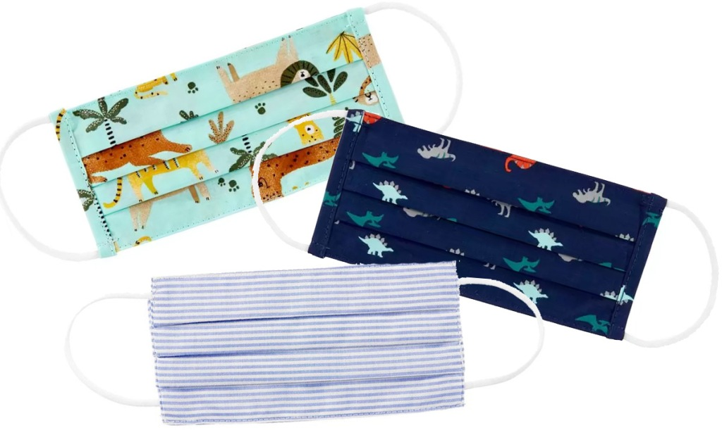 three kids reusable face masks in various prints