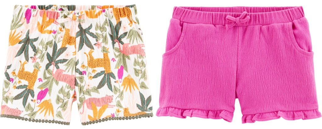 two pairs of Cater's toodler girls shorts in pink and green tropical print and solid pink with ruffle hem