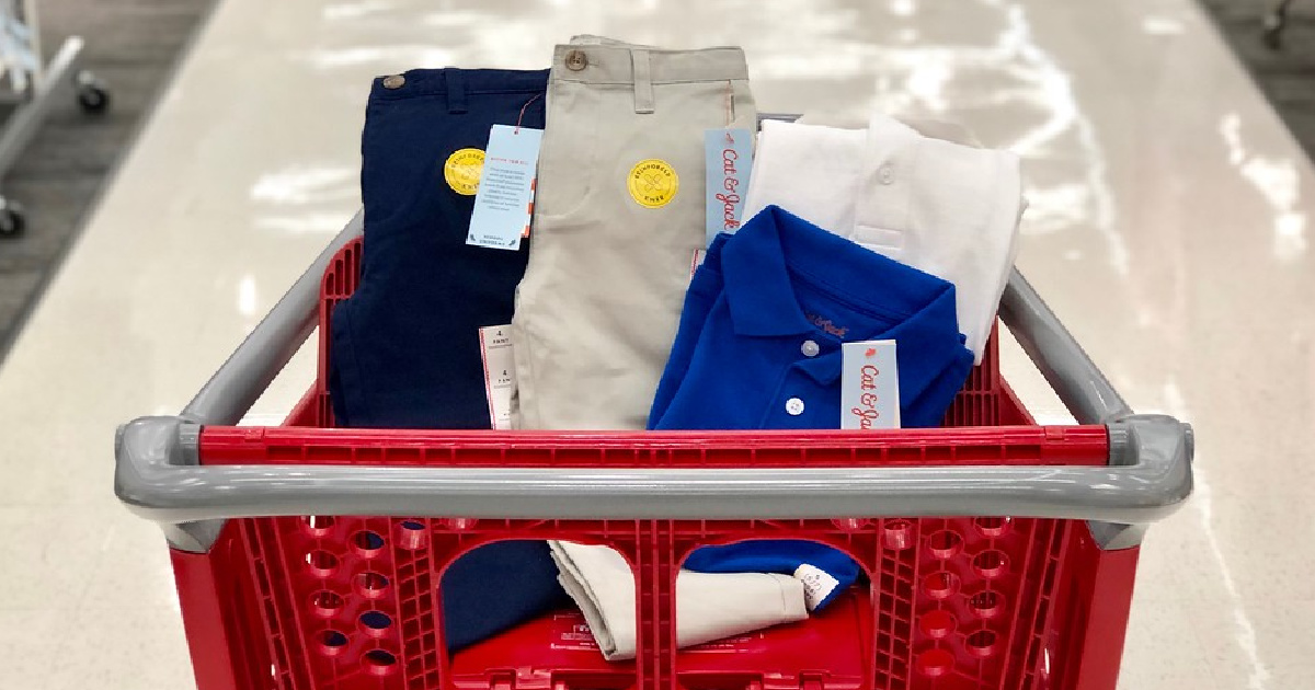various kids uniform apparel in red store shopping cart in store
