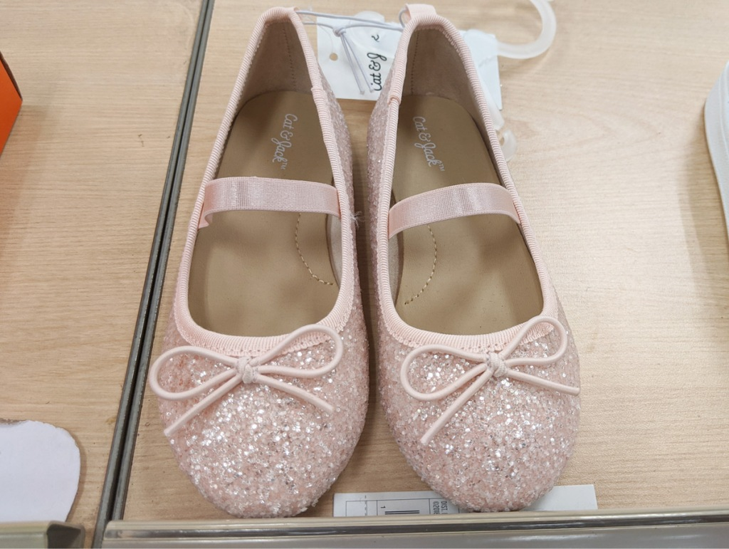 pair of sparkly toddler girls ballet flats with bows on tops