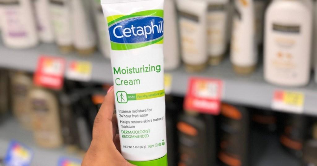hand holding Cetaphil Moisturizing Cream