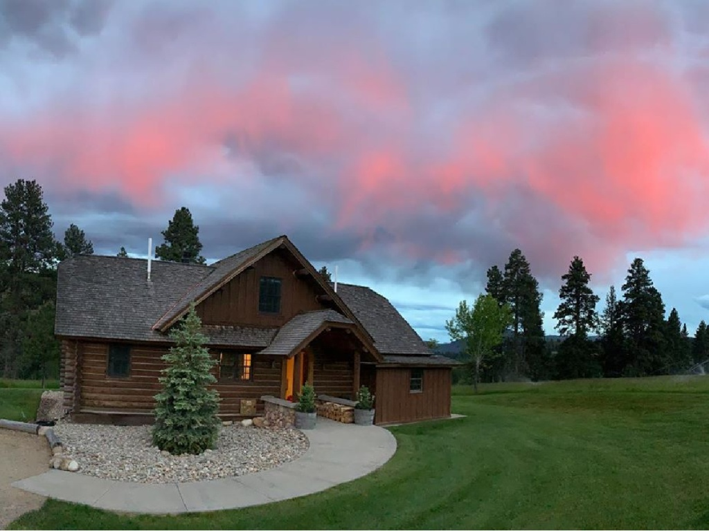 cabin with trees and sunset