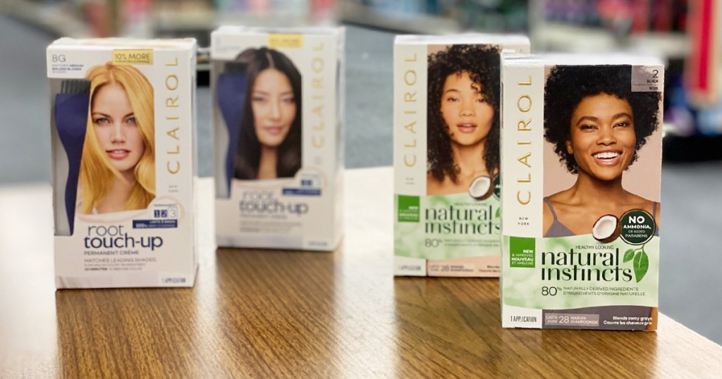 four white boxes of Clairol Hair Color on a wood table
