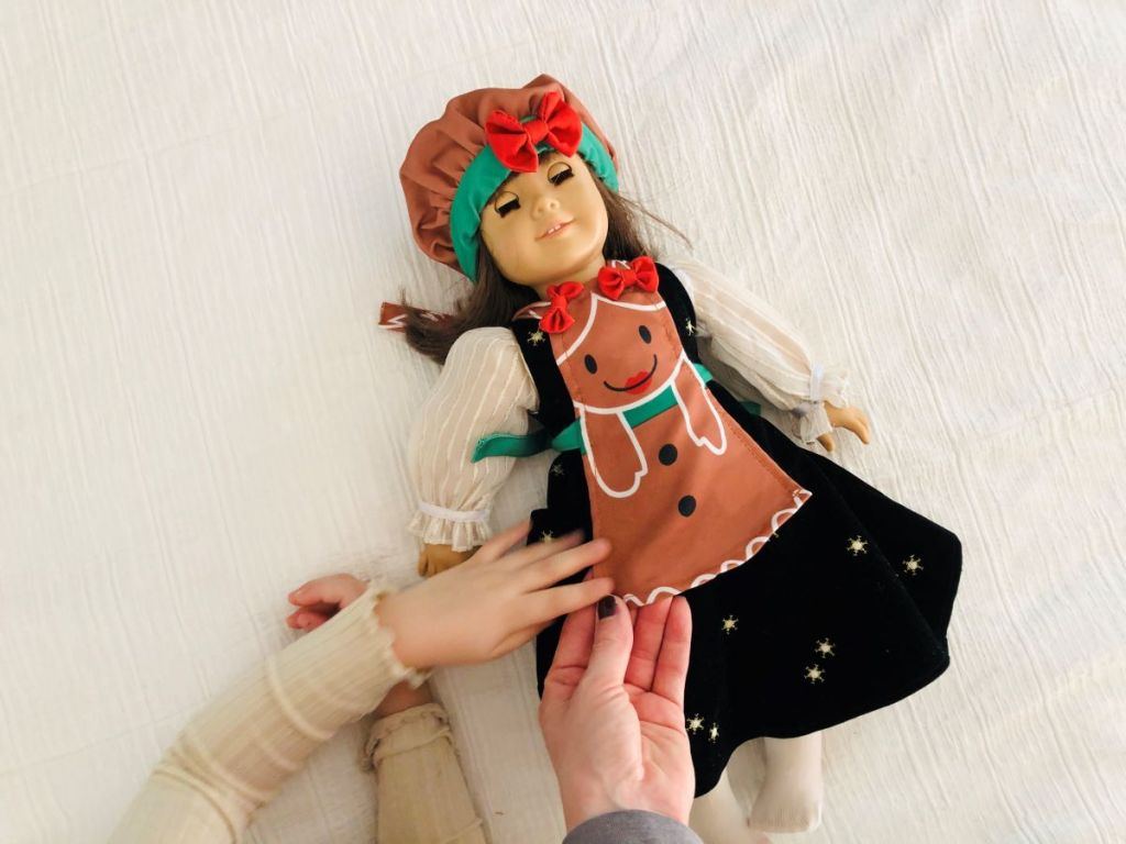 doll wearing a holiday apron
