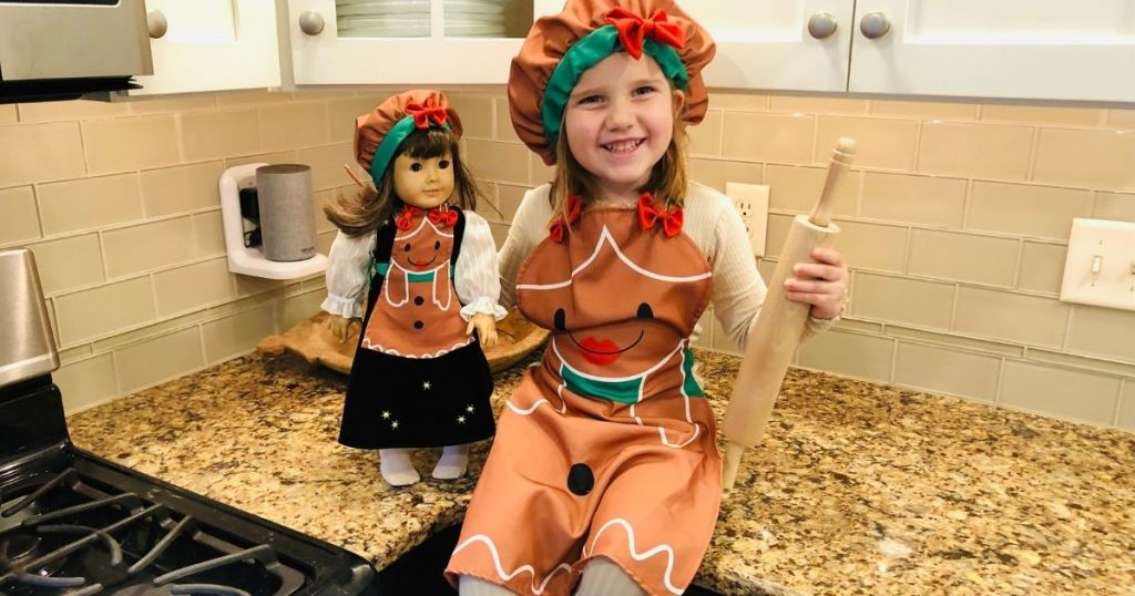girl and doll in matching apron set