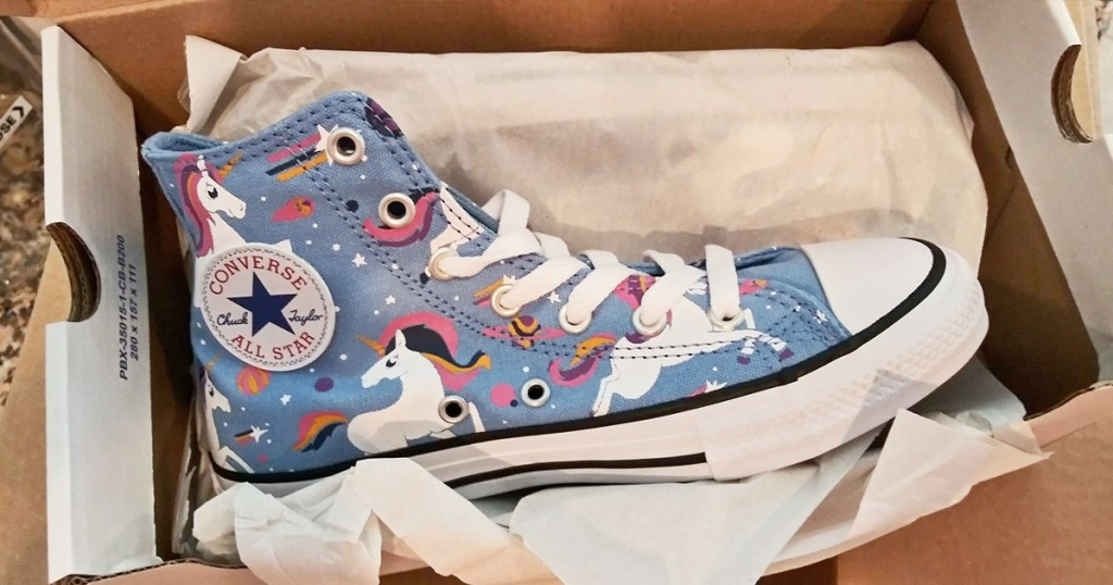 pair of blue high-top girls converse sneakers with unicorn print inside an opened shoe box with tissue paper