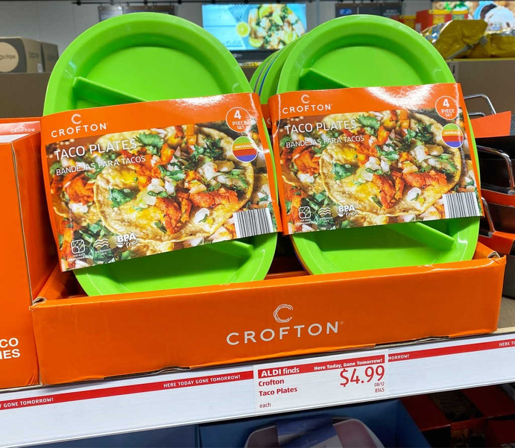 green 4-packs of taco plates in an orange box on an ALDI store shelf