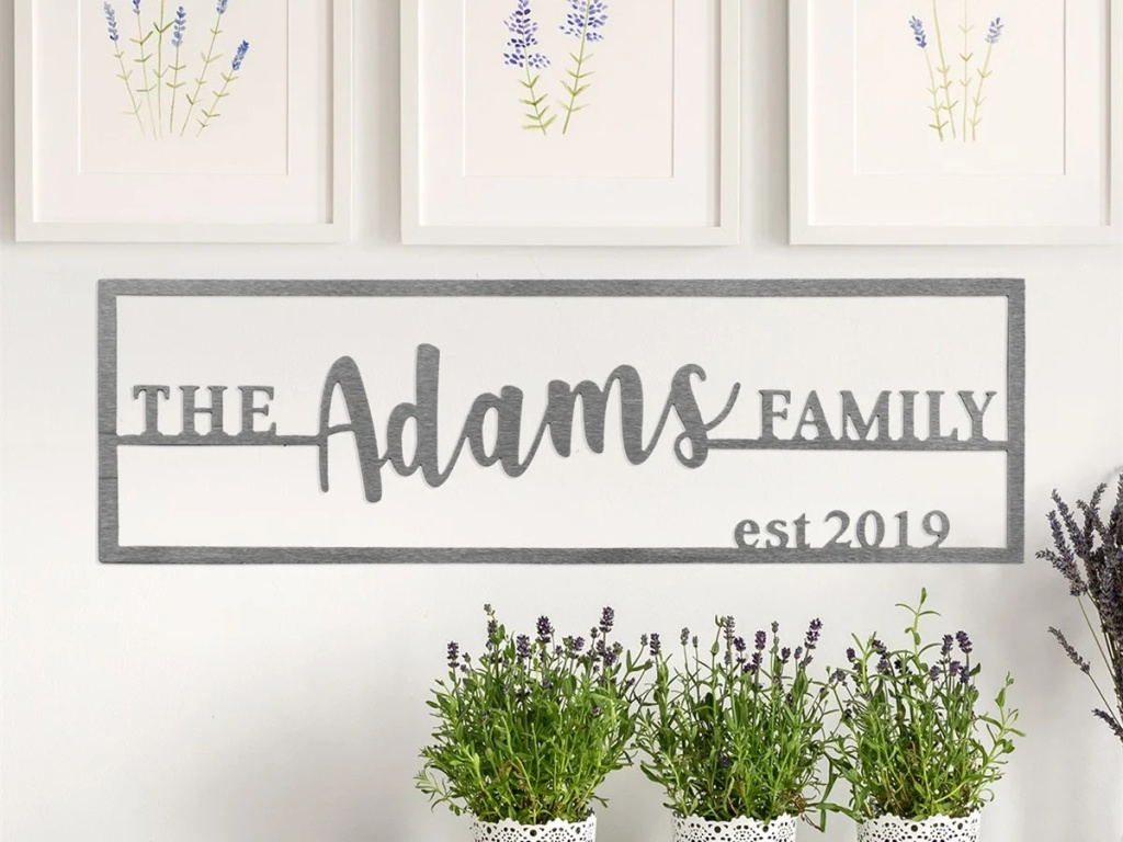 family name plaque on white wall, plants, and floral paintings
