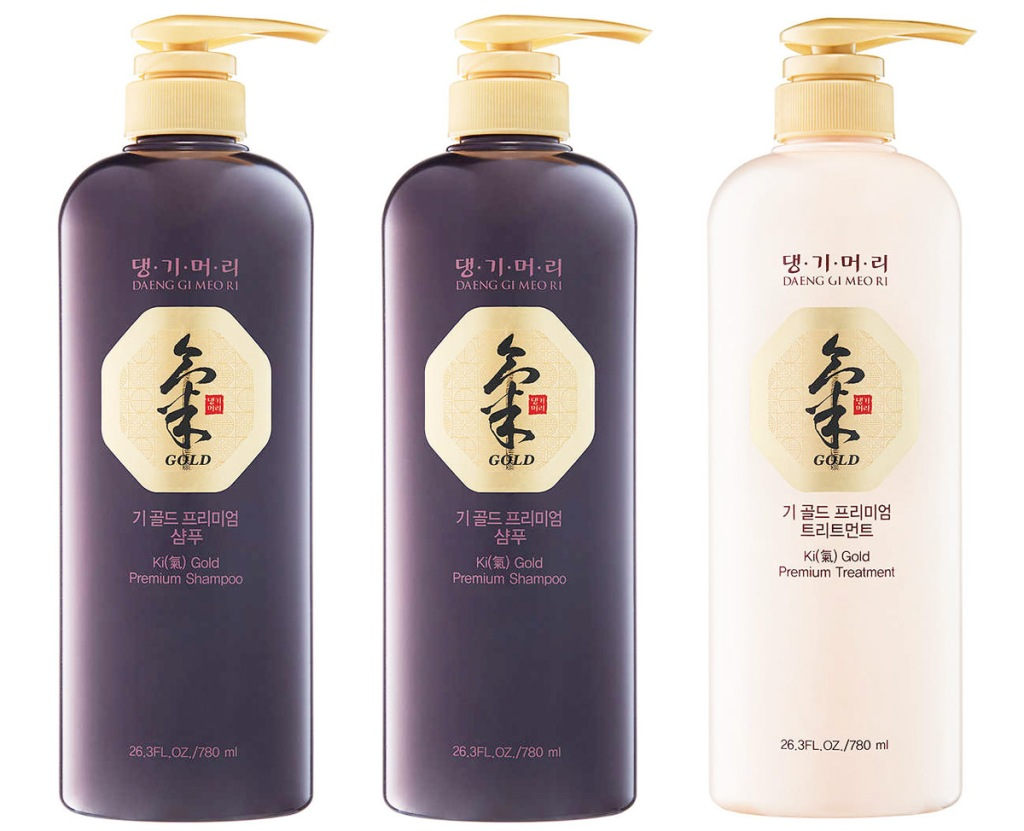 two brown and one cream colored bottles of Korean shampoo and conditioner with gold pump top dispensers