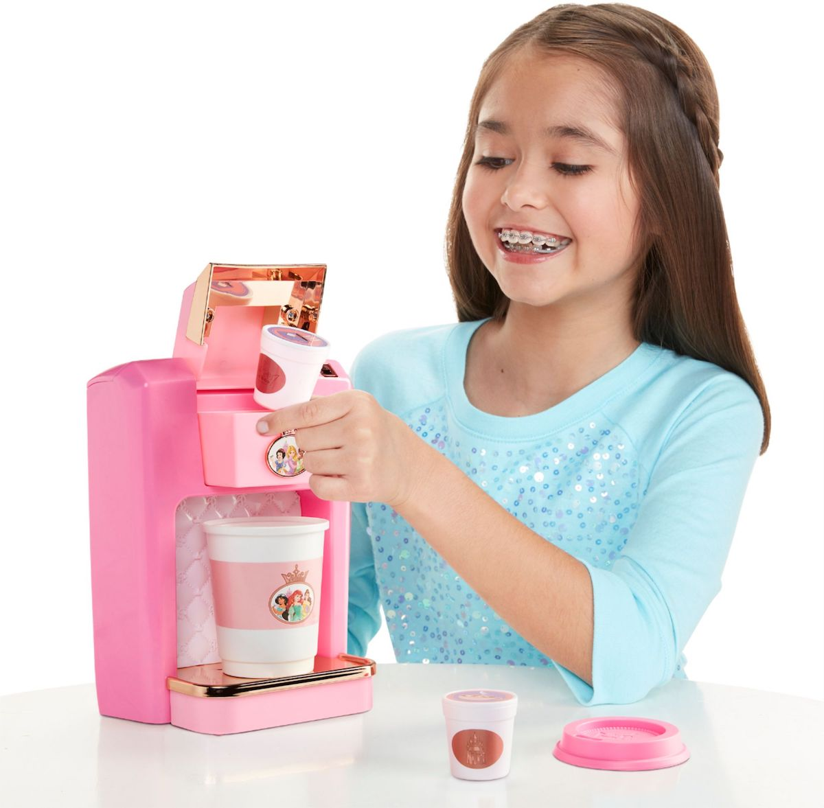 girl playing with Disney Princess Style Collection Play Gourmet Coffee Maker