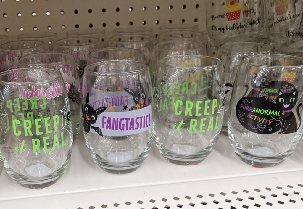 store shelf with stemless wine glasses with halloween prints on them