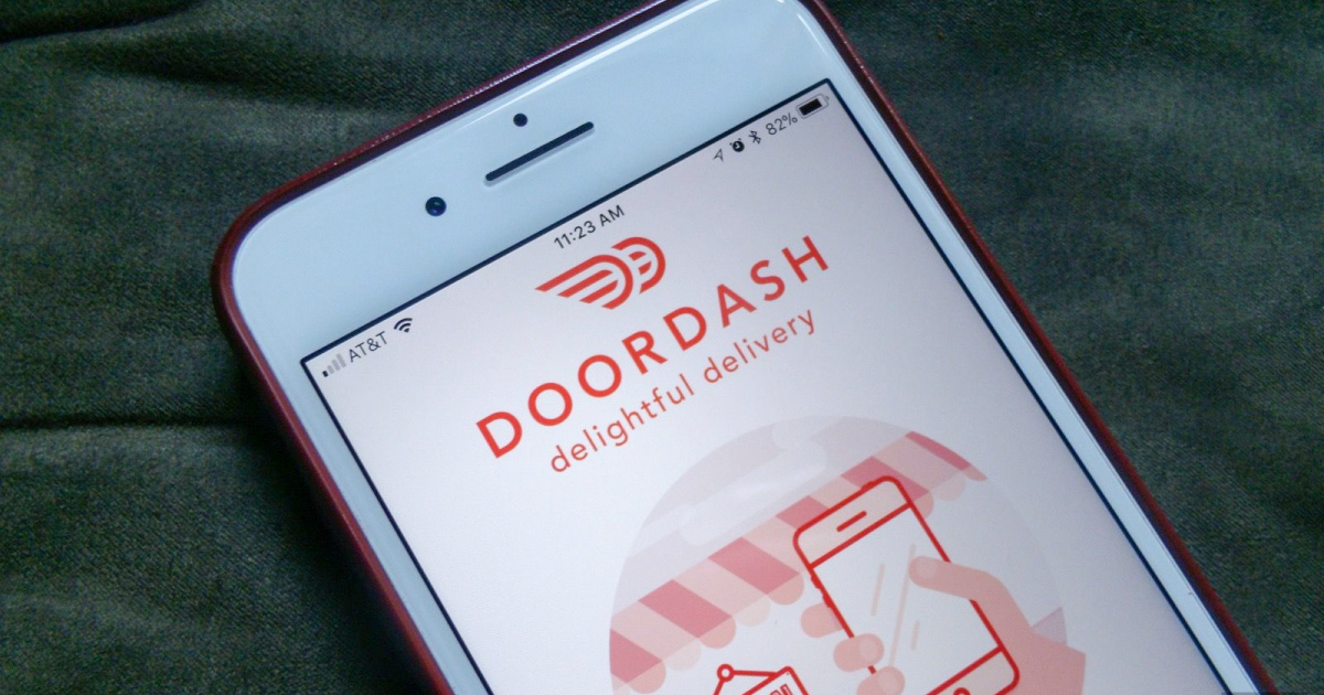 phone with food delivery service app open