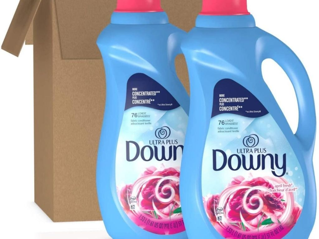 two bottles of fabric softener in front of a cardboard box