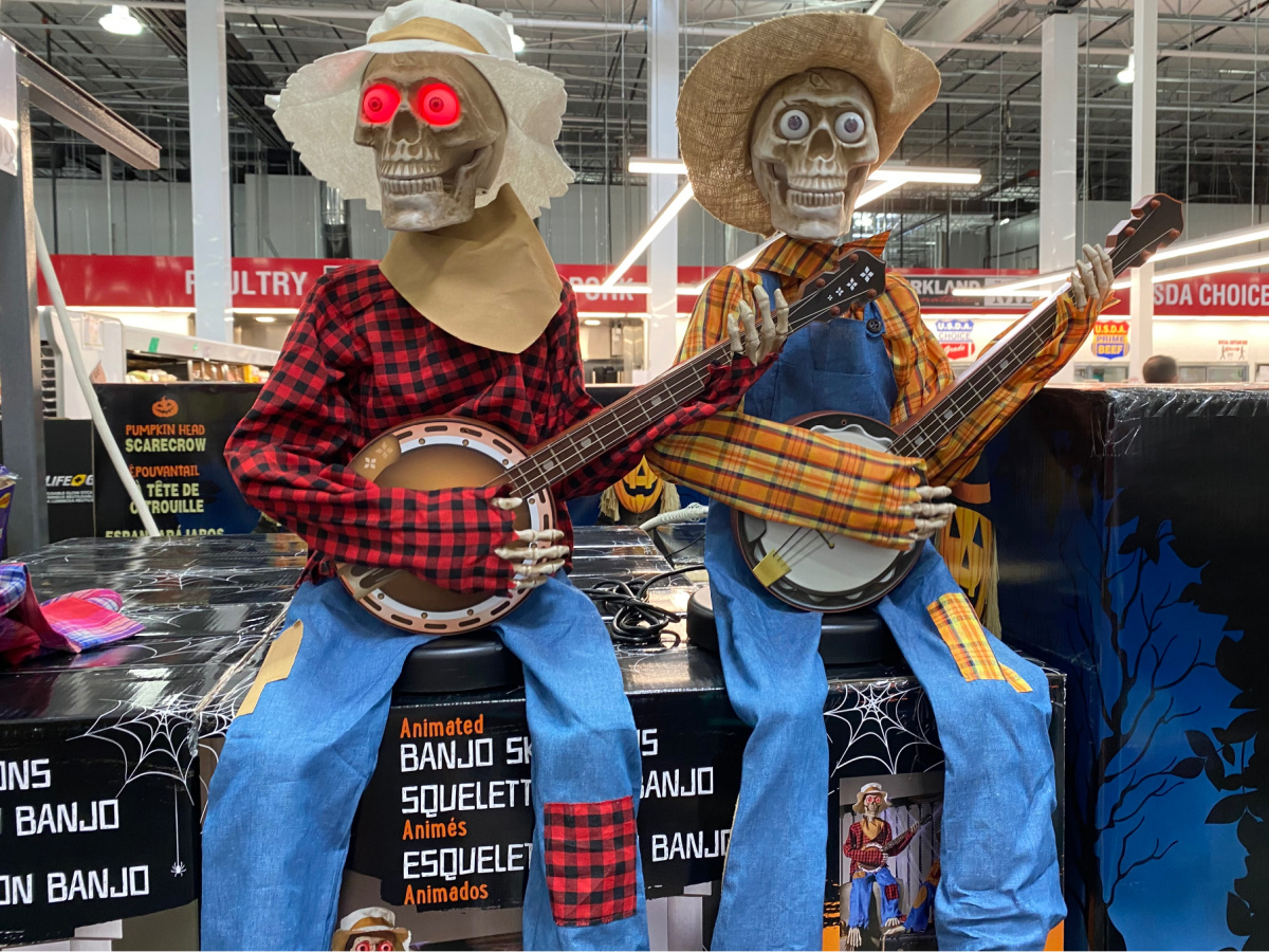 animated skeletons playing banjos sitting on boxes in store