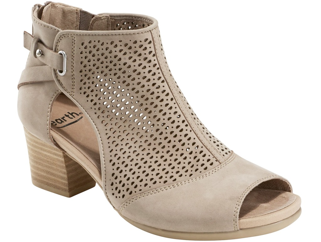 women's cream colored cut-out bootie with small buckle at ankle and block heel