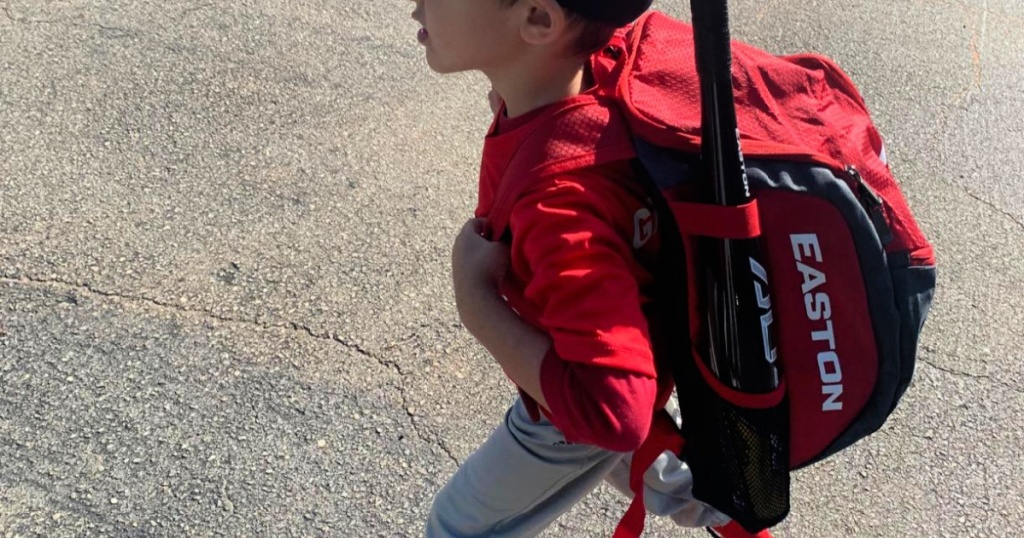 boy wearing red easton backpack