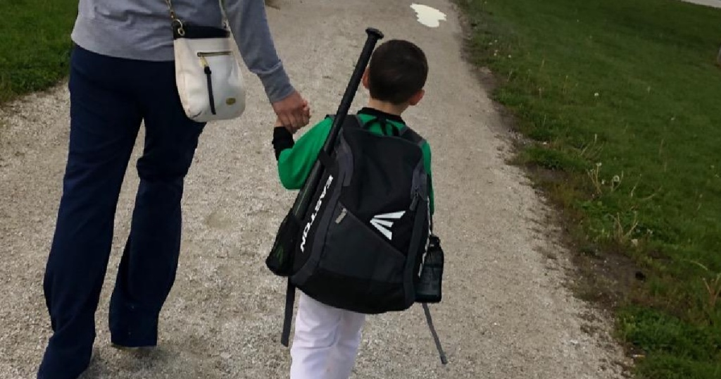 kid wearing black Easton Baseball Backpack
