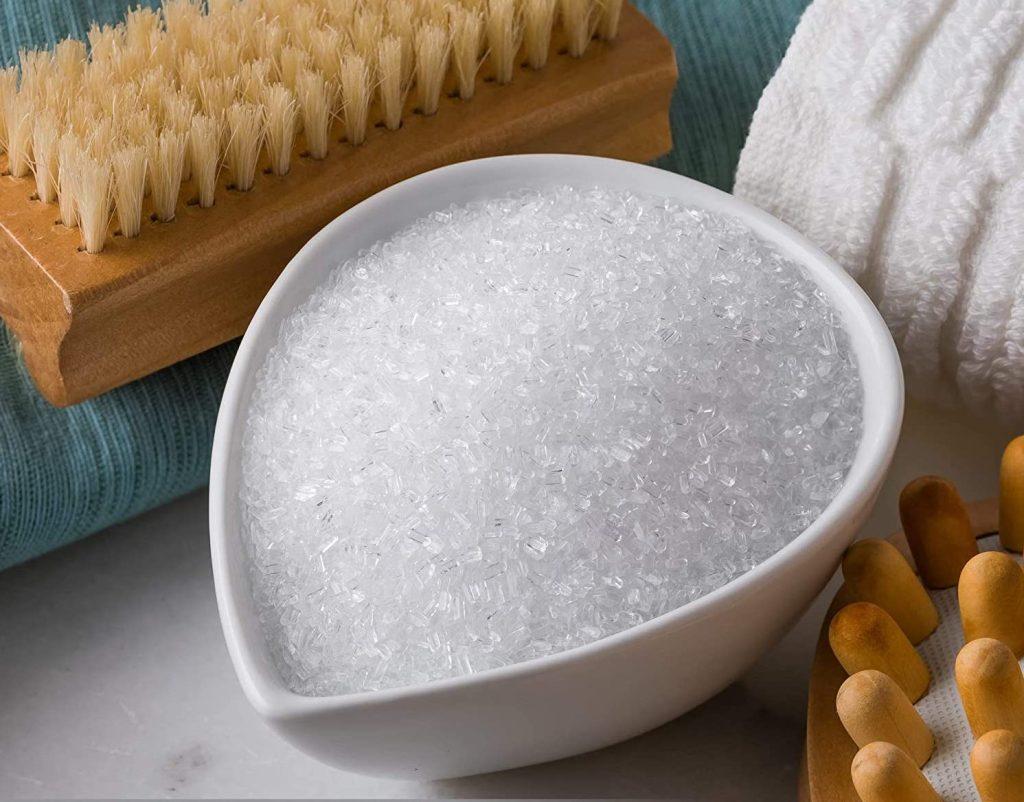Epsom Salt in bowl next to bath supplies