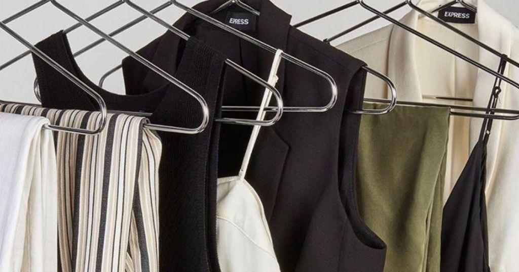 express clothing hanging on hangers