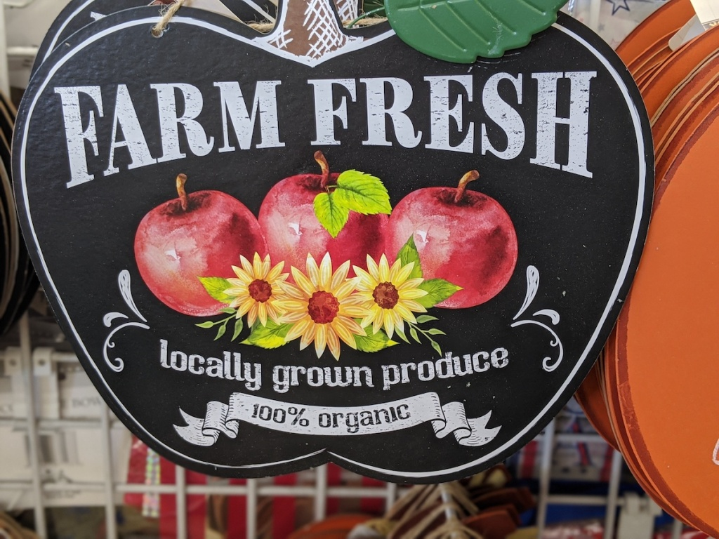 black wooden farm fresh sign with apples on it