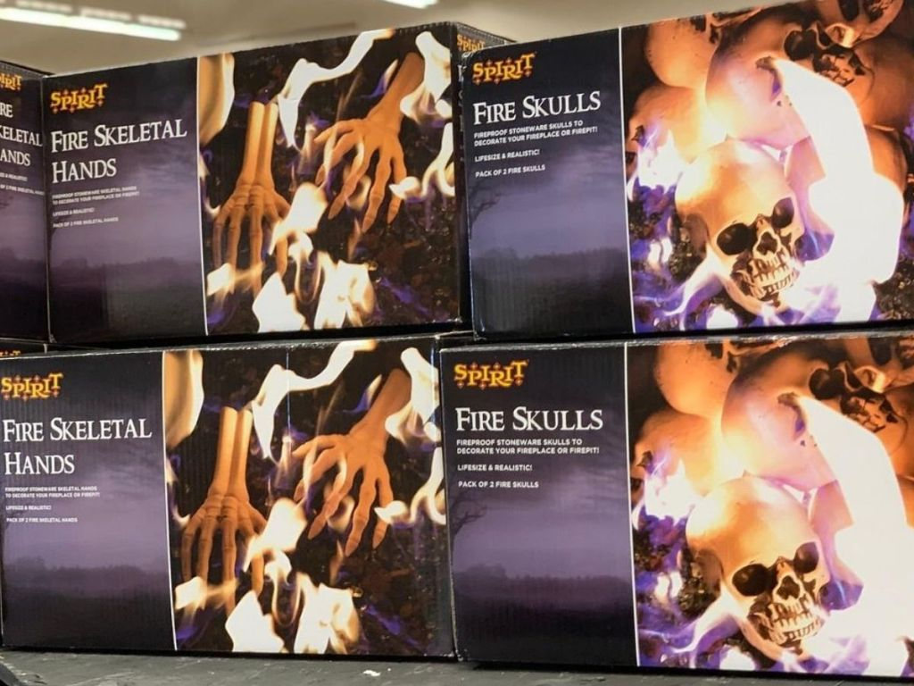 Boxes of Fire Skeleton Hands and Skulls on shelf at store