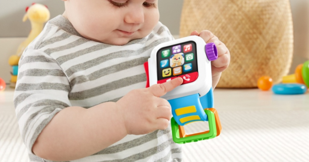 kid playing with Fisher-Price Laugh & Learn Time to Learn Smartwatch