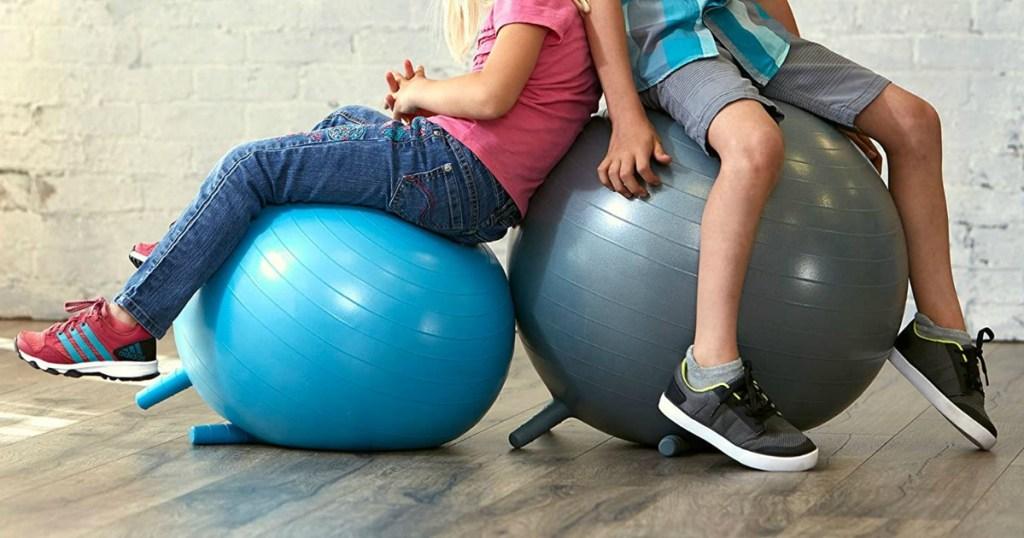 kids sitting on kids Gaiam balls