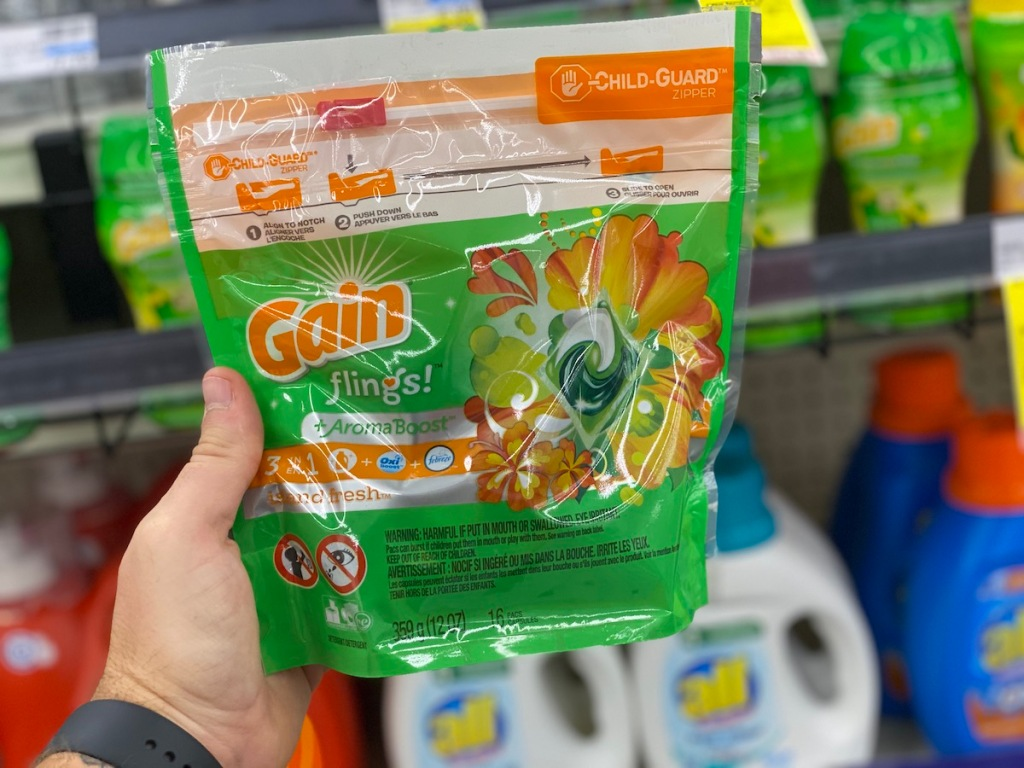 hand holding bag of Gain Flings 16 Count in cvs