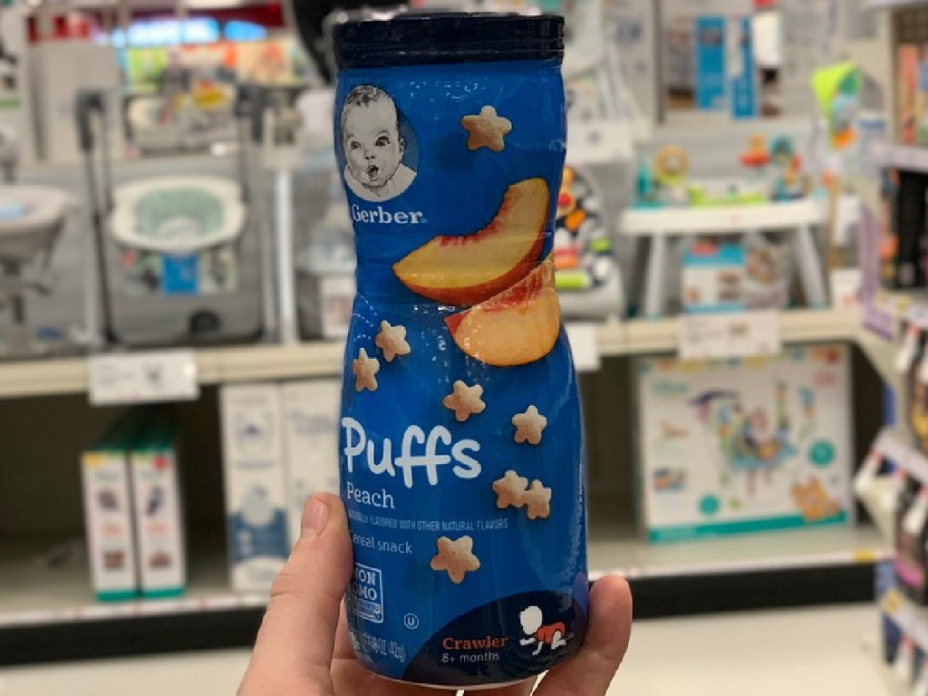hand holding kids puff cereal snacks