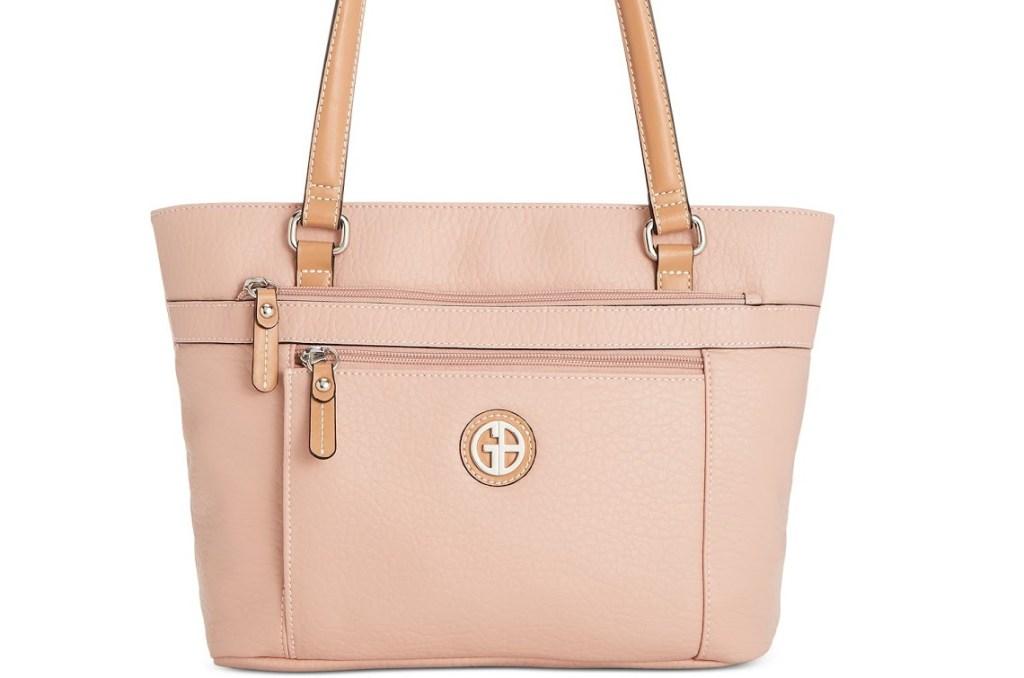 pink handbag with GB monogram on front