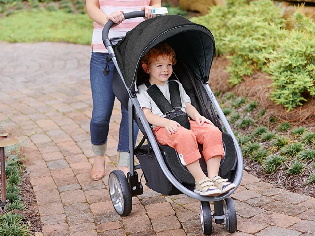 woman pushing a Graco Aire3 Click Connect Stroller