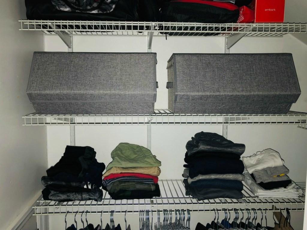 grey storage bins in a little boys closet