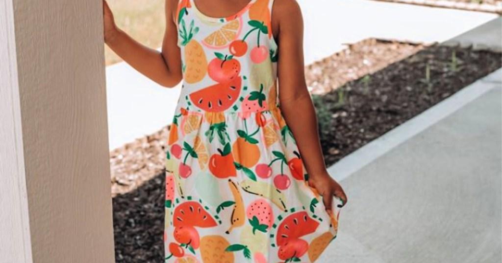 girl wearing flower h&m girls dress outside