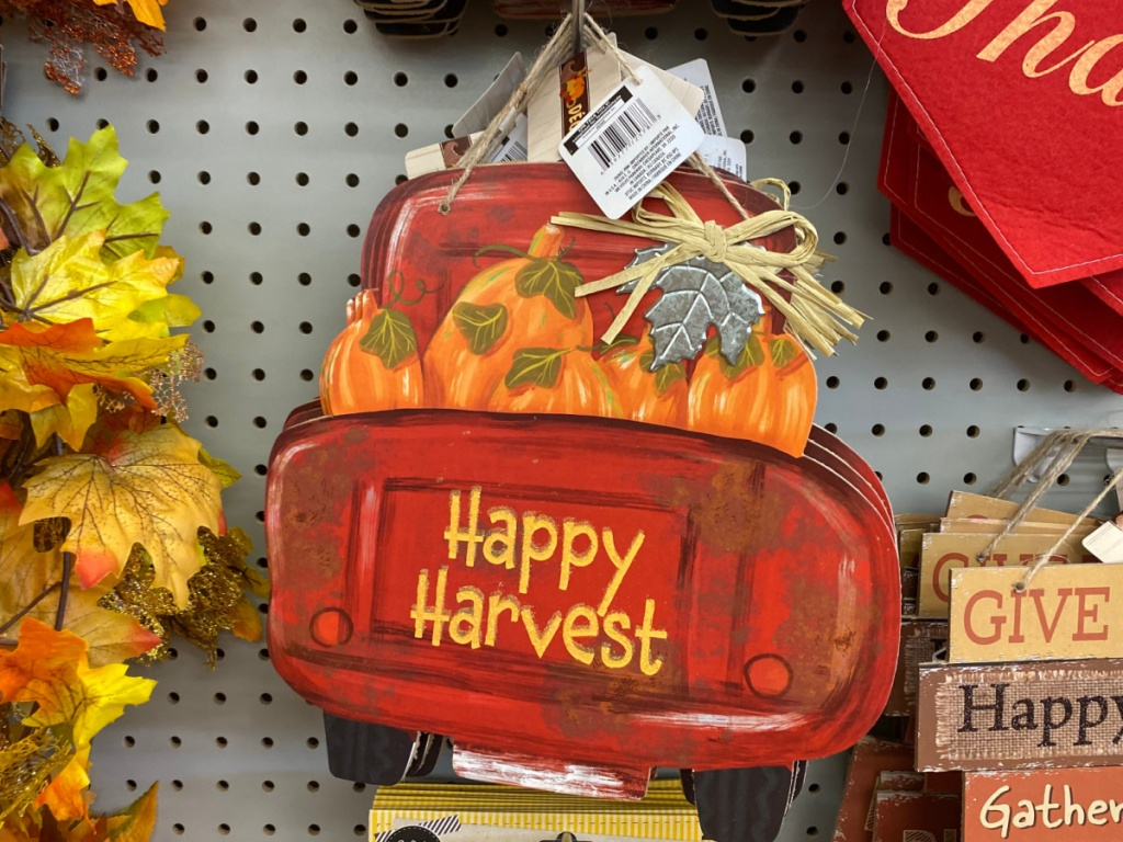 red truck harvest wall sign hanging in store