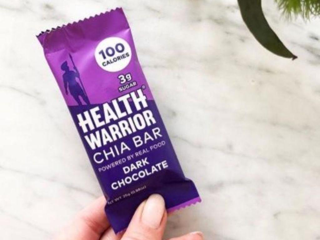 Health Warrior Chia Bar in woman's hand