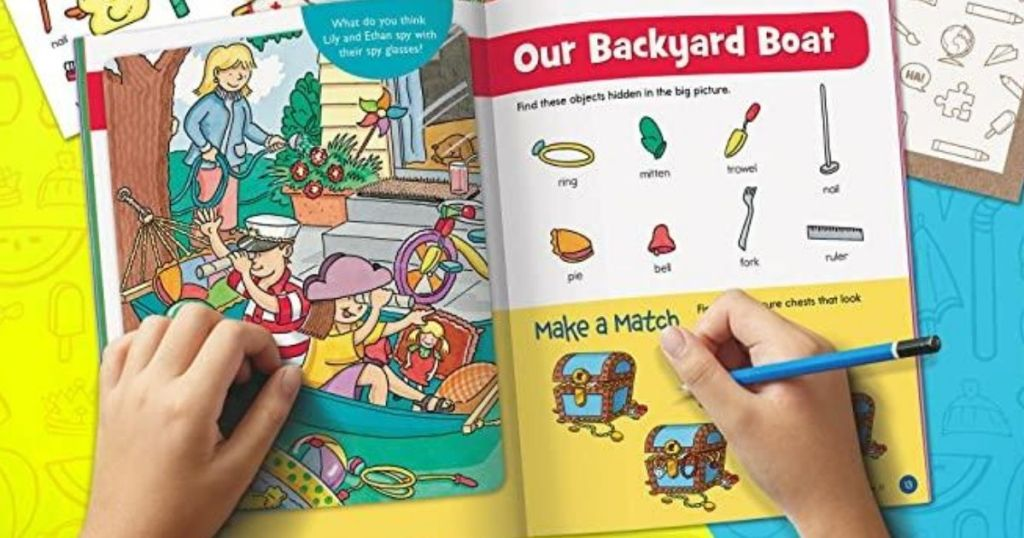 child using learning workbook
