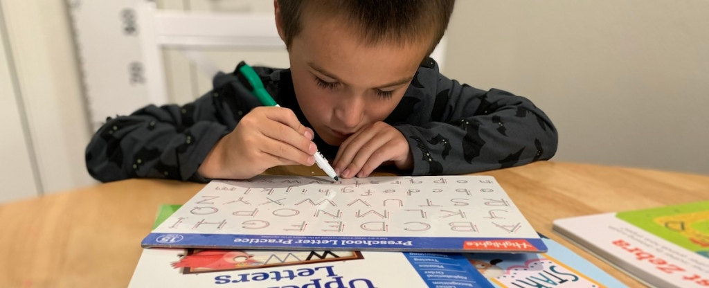 boy tracing letters