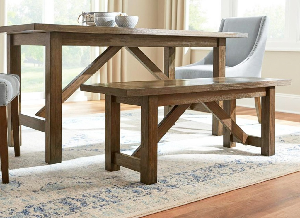 brown dining bench next to matching brown dining table