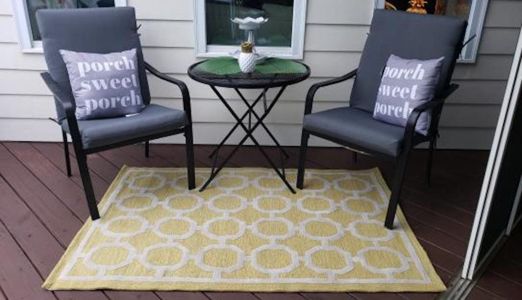 yellow and white patterned rug on outdoor patio
