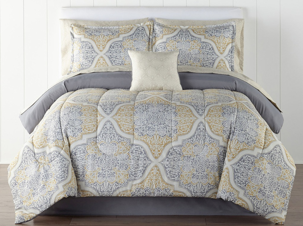 grey and yellow medallion print comforter set on bed with matching pillow cases and shams