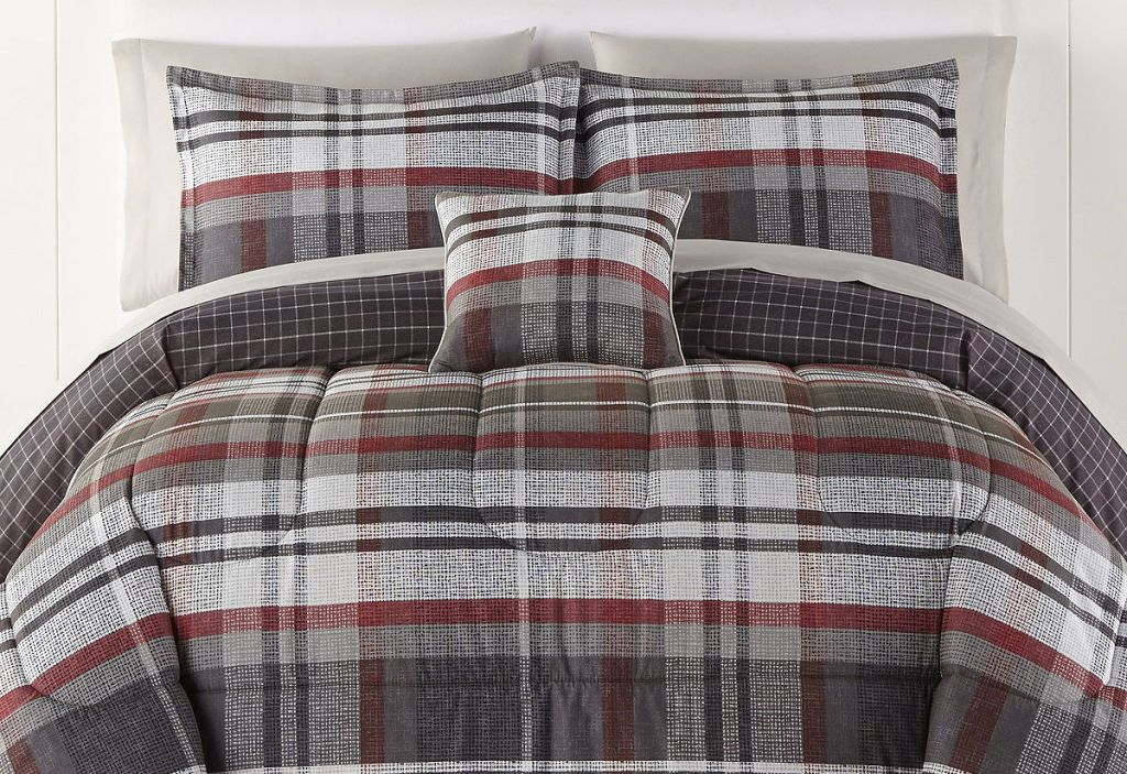 plaid bedding and pillows on a bed