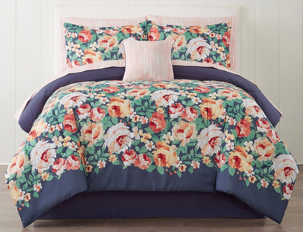 blue with bright floral pattern comforter set on bed with matching pillow cases and shams