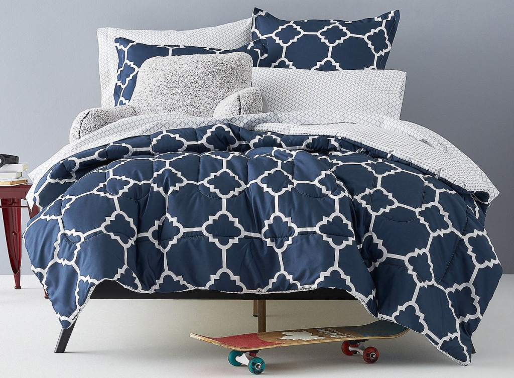 navy blue with white geographic print comforter on bed with matching pillow cases and shams