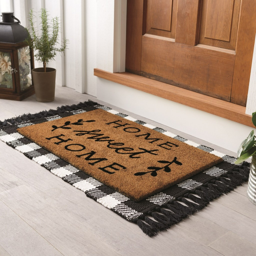 woven rug under a doormat by a front door