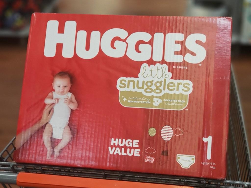 large huggies diaper box sitting in a walmart shopping cart