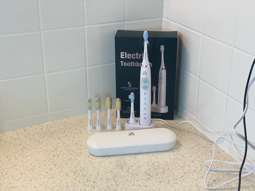 proalpha electric toothbrush with brush heads charged
