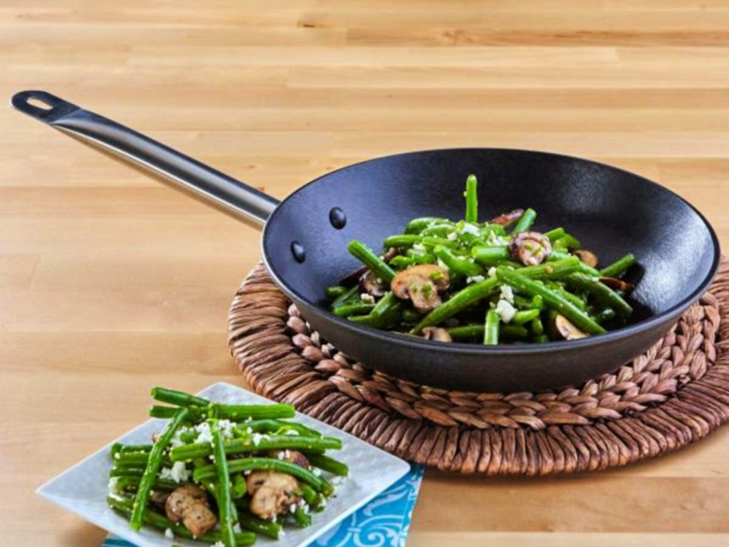 "green beans and mushrooms in an IMUSA 11"" Light Cast Iron Saute Pan with Stainless Steel Handle"