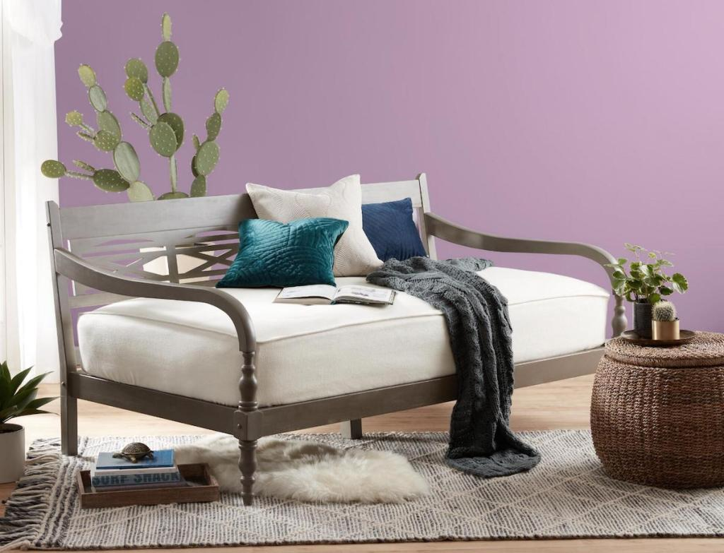 bedroom with daybed and plants
