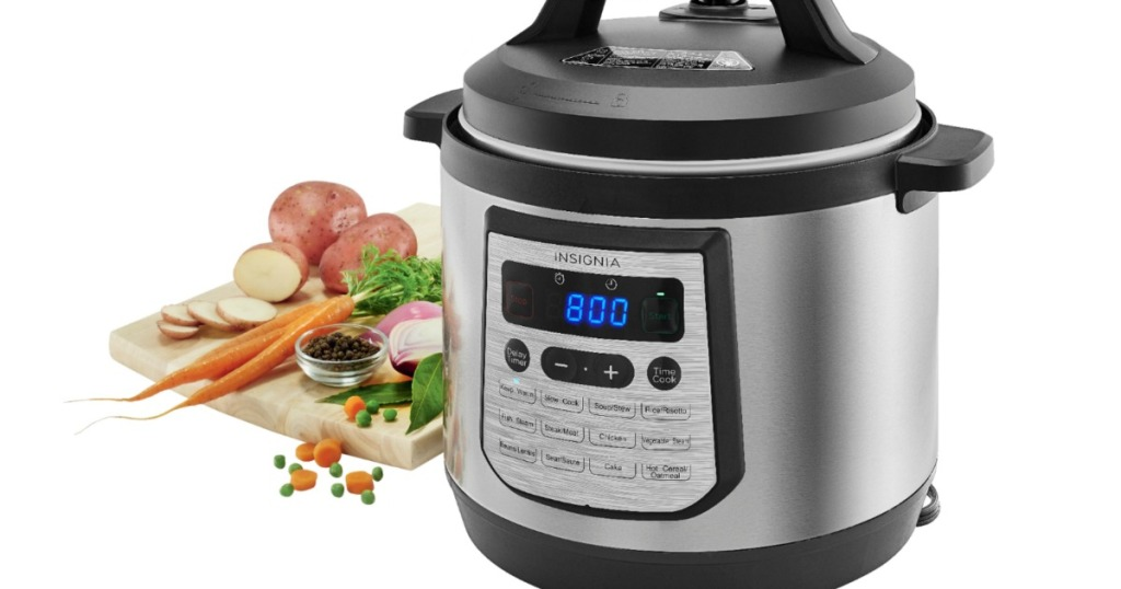 Insignia multi cooker with food on a cutting board