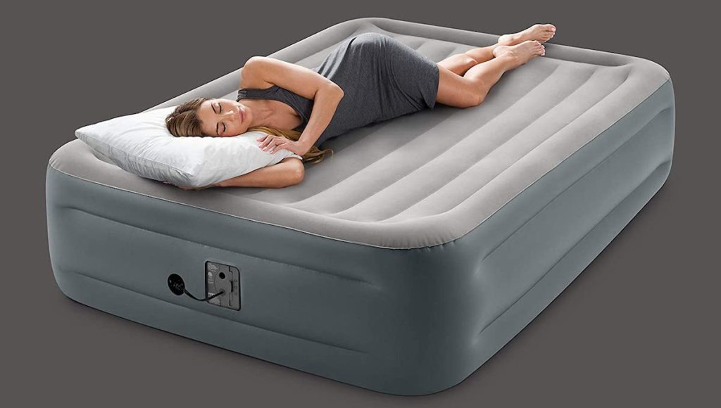 woman laying on an airbed